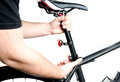 Bike seat adjustment using the clamp Royalty Free Stock Photos