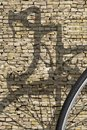 Bike shadow brick wall Royalty Free Stock Photo