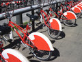 Bike Sharing in Barcelona, Spain. Long row of red and white publ Royalty Free Stock Photo