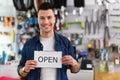 Bike Shop Owner Holding Open S...