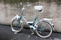 Bike snow near wall Royalty Free Stock Photography