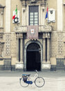 Bike in a square in front historic building. Nobody Royalty Free Stock Photo