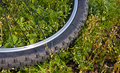 Bike wheel closeup on grass Royalty Free Stock Image