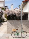 A bike with a wood basket chained to a pole. Royalty Free Stock Photo