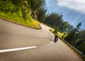 Biker in austrian mountains riding on curve road alps europe speed and freedom concept luxury transport active travel and tourism Stock Photography
