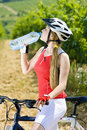 Biker with bottle of water Royalty Free Stock Images
