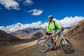 Biker-boy in Himalaya mountains Royalty Free Stock Photo