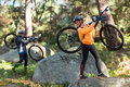 Biker couple holding their mountain bike and walking in forest Royalty Free Stock Photo