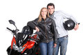 Biker couple stod by motorcycle Royalty Free Stock Photos