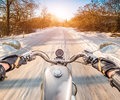 Biker first person view winter slippery road rides on Royalty Free Stock Photos