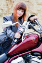 Biker girl on a motorcycle Stock Image