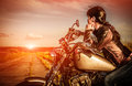Biker girl on a motorcycle Royalty Free Stock Photo