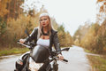 Biker girl rides a motorcycle in the rain. First-person view Royalty Free Stock Photo