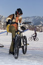 Biker in helmet in winter mountains Royalty Free Stock Photography