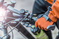 Biker Holds Bike Helm