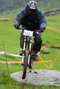 Biker jump on downhill race Stock Photography