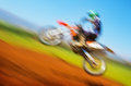 Biker on motocross blurred image of championship active lifestyle extreme sport slow motion off road speed concept Stock Images