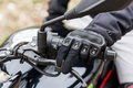 Biker on motorcycle, close-up view on hands on handlebars. Royalty Free Stock Photo