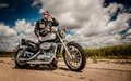 Biker on the road Royalty Free Stock Photo