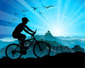 Biker Silhouette  with mountains Royalty Free Stock Photo