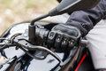 Biker sitting on motorcycle, close-up view on hands on handlebar Royalty Free Stock Photo