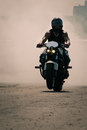 Biker speeding on a road man in helmet riding motorcycle Stock Images