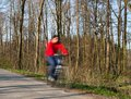 Bikers on a biking path in a park Stock Photos