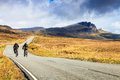 Bikers on a highway through a desolate landscape Royalty Free Stock Photo