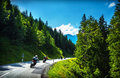 Bikers in mountainous tour travelling across europe curve highway mountains scene destinations extreme transport active Royalty Free Stock Images