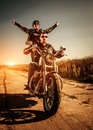 Bikers on the road couple in a leather jacket riding a motorcycle Royalty Free Stock Photo