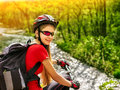 Bikes bicyclist girl rides bicycle mountains. Woman on vehicle mountaineering. Royalty Free Stock Photo