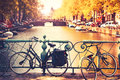 Bikes on the bridge in Amsterdam, Netherlands. Royalty Free Stock Photo