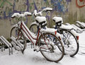 Bikes covered with snow Stock Photography