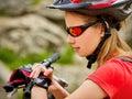 Bikes cycling girl. Bicyclist girl watch on smart watch.