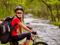 Bikes cycling girl with big rucksack cycling fording throught water rides bicycle trip is good for health Stock Photography