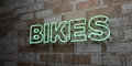 BIKES - Glowing Neon Sign on stonework wall - 3D rendered royalty free stock illustration Royalty Free Stock Photo