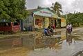 Biking on rain soaked road in the tropics Royalty Free Stock Photo