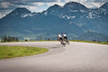 Biking two bikers on the road in mountains with alps in background salzkammergut austria Royalty Free Stock Photography