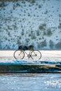 Biking in winter bike snowy field Stock Photo