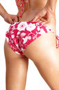 Bikini bottom a closeup picture of a young woman s in a pink panties for white background Royalty Free Stock Photo