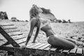 Bikini girl model sunbathe on beach Royalty Free Stock Photo