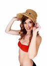 Bikini girl with straw hat a young pretty woman in a red top holding a on her head for white background Stock Photography