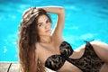 Bikini model. Beautiful sexy brunette girl model with long wavy Royalty Free Stock Photo