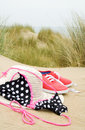 Bikini, sun hat and shoes on beach Royalty Free Stock Photo