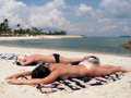 Bikini topless sunbathing Royalty Free Stock Photo
