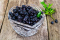 Bilberry in Crystal Bowl on Rustic Background Royalty Free Stock Photo