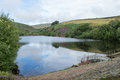 Bilberry reservoir near holmfirth broke its banks in killing people looks very peaceful today Royalty Free Stock Photo
