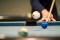 Billard jump shot a on a blue pool table Royalty Free Stock Photo