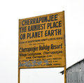 A billboard displaying the rainiest place in earth yellow at cherrapunjee meghalaya india Stock Image