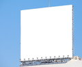 Billboard with empty screen against blue cloudy sky Royalty Free Stock Images